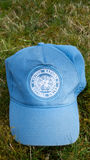 United Nations Hat. A blue United Nations Cap lying in grass Stock Photos