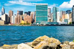 The United Nations headquarters and the New York skyline. The United Nations headquarters and the midttown Manhattan skyline royalty free stock images