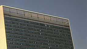 United Nations headquarters. New York, United States of America - circa 1970: vintage tilt shift of United Nations headquarters skyscraper, from Circle Line stock video footage