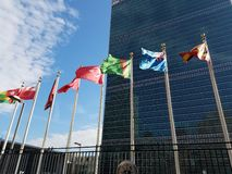 United Nations Headquarters with raised flags royalty free stock photography