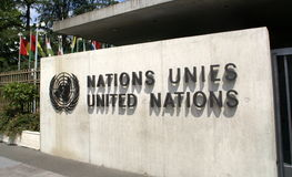 United Nations im Geneva: entrance. View of the entrance to United Nations (Palace of Nations) and world flags in Geneva, Switzerland. United Nations is one of Royalty Free Stock Photo