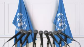 The United Nations official press conference. Flags of the UN and microphones. Conceptual editorial 3D rendering royalty free illustration