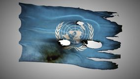 United Nations perforated, burned, grunge waving flag loop alpha stock footage