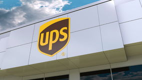 United Parcel Service UPS logo on the modern building facade. Editorial 3D rendering. United Parcel Service UPS logo on the modern building facade. Editorial 3D stock illustration