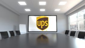 United Parcel Service UPS logo on the screen in a meeting room. Editorial 3D rendering. United Parcel Service UPS logo on the screen in a meeting room. Editorial Stock Photography