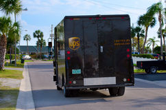 United Parcel Service UPS truck van delivery. UPS truck van making a delivery in a residential neighborhood on a beautiful sunny day Stock Photo