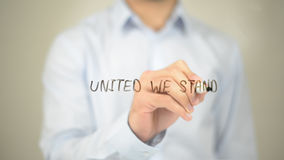 United We Stand, Man Writing on Transparent Screen. High quality Stock Photography