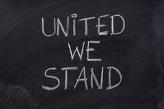 United we stand phrase on blackboard Stock Photo