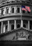 United State Capitol Building with Flag. United State Capitol Building for congress with american flag flowing in breeze and columns in background stock photography