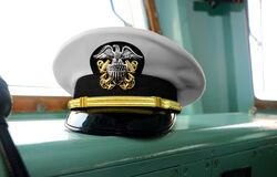 Free United State Navy USN Officer`s Hat On Naval Ship`s Command Bridge At Malaysian Royalty Free Stock Image - 175351116