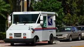 United Stated Postal van on the street. 4k video of a USPS delivery truck on the streets stock video