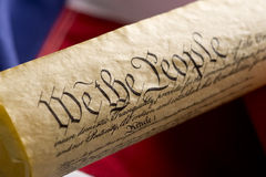 United States. A copy of the United States Constitution on an Amercan Flag Background Stock Photos