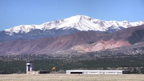 United States Air Force Academy Airfield from Ackerman Overlook. The beautiful United States Air Force Academy Airfield with snow mountain - Ormes Peak from stock video footage
