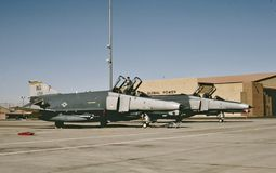 USAF F-4E at Nellis AFB getting for its next mission in 1995. United States Air Force McDonnell F-4E Phantom 69-0258 CN 3787 getting ready for its next mission stock image