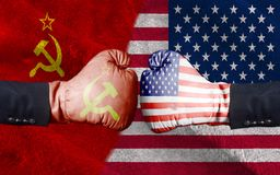 United States of America against USSR boxing gloves, USA vs. USSR concept half flags together. Background close up royalty free stock photo