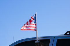 United States of America car window flag. A car with a clip-on United States of America window flag waving in the wind Royalty Free Stock Photo