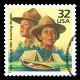 US Postage stamp. UNITED STATES OF AMERICA - CIRCA 1998: A stamp printed in USA shows Boy Scouts started in 1910, Girl Scouts formed in 1912, series Celebrate stock photography