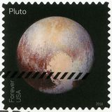 USA - 2016: shows The Pluto, series Pluto-Explored. UNITED STATES OF AMERICA - CIRCA 2016: A stamp printed in USA shows The Pluto, series Pluto-Explored, circa Stock Image