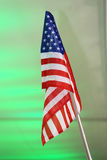 United States of America flag as a colorful background. Flag of United States of America against green background Royalty Free Stock Photo