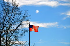 United States of America Flag with Blue Sky Background Royalty Free Stock Photography
