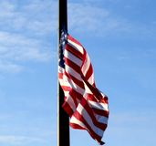 United States of America Flag flapping in the wind at half staff stock photo
