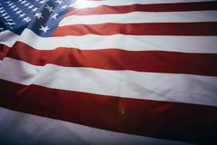 United States of America flag. Image of the american flag flying in the wind. American flag waving in the wind royalty free stock image
