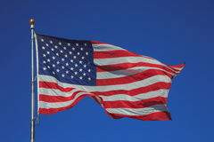United States of America flag waving in the sky Royalty Free Stock Images