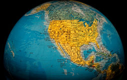 United States of America Globe. A view of the United States on an illuminated globe against a black background Royalty Free Stock Photo