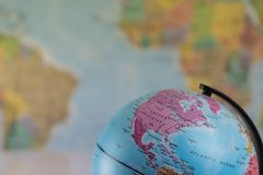 The United States of America on the map globe with blurred map as background.  Stock Photo