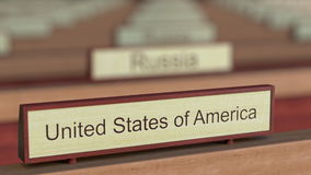 United States of America name sign among different countries plaques at international organization. 3D rendering Royalty Free Stock Image