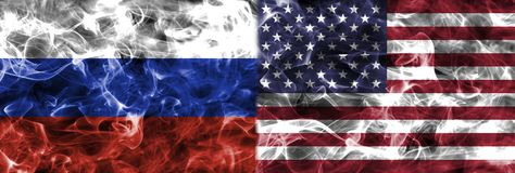 United States of America and Russia smoke flag. Isolated on a black background Royalty Free Stock Photography
