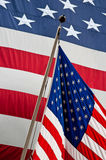 United States of America's flag. One banner in the background, one flag in the foreground Royalty Free Stock Photography