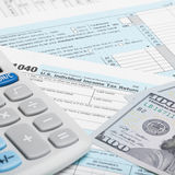 United States of America Tax Form 1040 with calculator and US do - 1 to 1 ratio Royalty Free Stock Photo