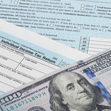United States of America Tax Form 1040 with 100 dollars banknote - 1 to 1 ratio Stock Image