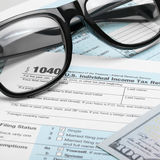 United States of America Tax Form 1040 with dollars and glasses - 1 to 1 ratio Stock Photo