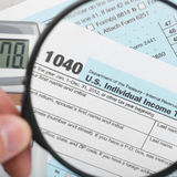 United States of America Tax Form 1040 with magnifying glass - 1 to 1 ratio Stock Image
