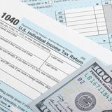 United States of America Tax Form 1040 with two 100 dollars bank - 1 to 1 ratio Royalty Free Stock Photos