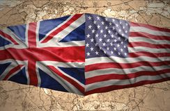 United States of America and United Kingdom. Waving United States of America and British flags on the background of the political map of the world Stock Photography