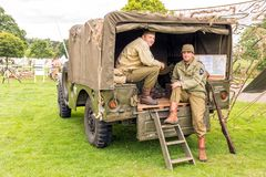 United States Army Infantry WW11. Re-enactors dressed in WW2 uniforms of the United States Army 2nd Infantry Division and sitting in the back of a Dodge WC Royalty Free Stock Images