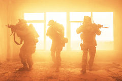 United States Army rangers in action. United States Army rangers during the military operation in the smoke and fire Royalty Free Stock Image