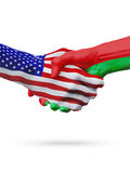 United States and Belarus flags concept cooperation, business, sports competition. United States and Belarus, countries flags, handshake concept cooperation royalty free stock photos