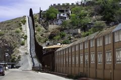 United States Border Wall with Mexico in Nogales Arizona. United States border wall with Nogales Mexico neighborhood on the right royalty free stock image