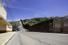 United States Border Wall with Mexico at Nogales Arizona. United States border wall with Nogales Mexico behind on the right stock photos