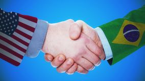 United States - Brazil  / Handshake concept animation about countries and politics / With matte channel. Handshaking of the men wearing flag pattern suit 4K stock video footage