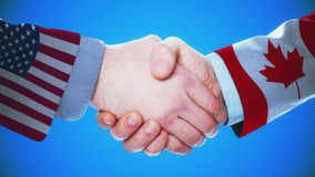 United States - Canada / Handshake concept animation about countries and politics / With matte channel. Handshaking of the men wearing flag pattern suit 4K stock footage