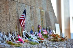 United States and Canadian flags, flowers and objects in memory of fallen in Normandy landing. stock photo