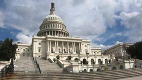 United States Capital Building, Slow Zoom from Left Washington DC Wide Angle. With a Blue Sky and light Cloud Cover stock video footage