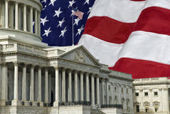 United States Capital with Flag. The United States Capitol Building in Washington DC with a U.S.A. flag in the background. A grunge effect has been applied Stock Photos