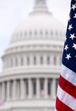 United States Capitol. An american flag, shown in front of the Capitol building dome Stock Photo