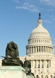 United States Capitol building. Exterior of United States Capitol building with lion statue in foreground, Washington D.C, U.S.A Stock Photos